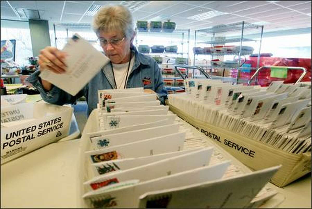 King County Elections staff member Bev Jones sorts ballots for the viaduct election at King County's Temporary Elections Annex in Tukwila.