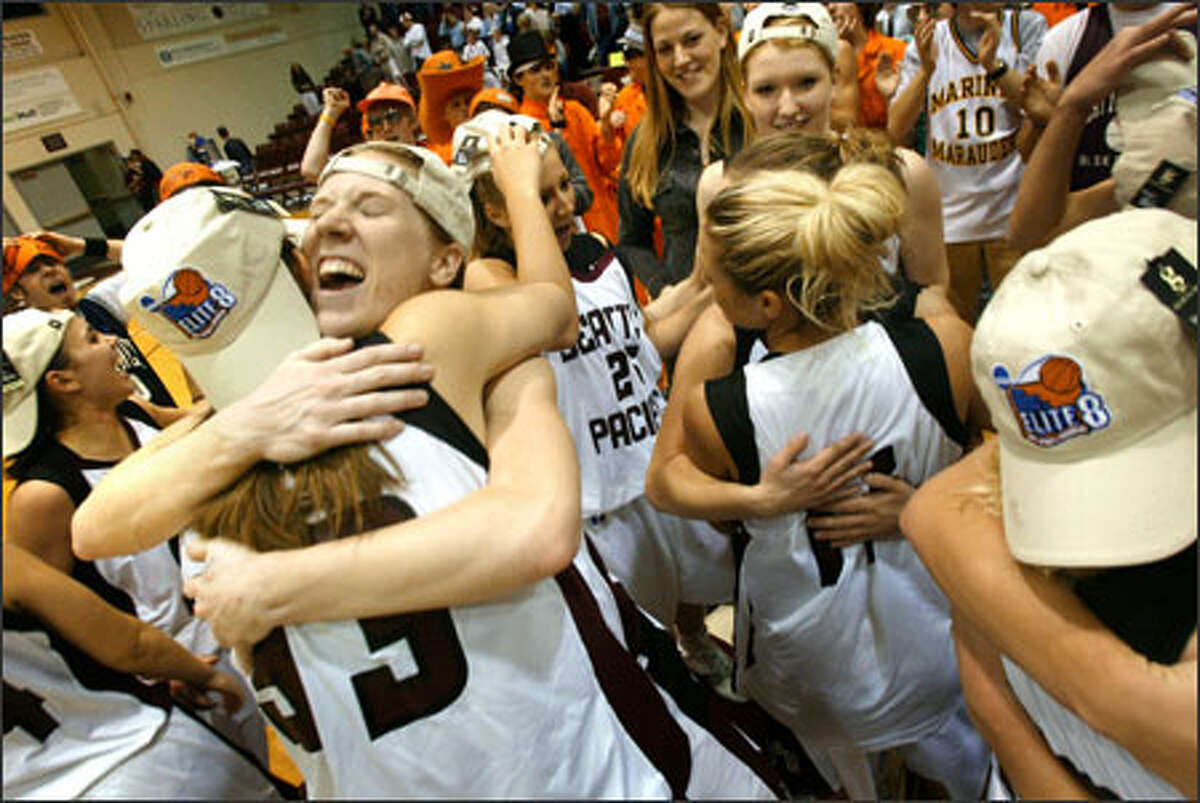 Seattle Pacific University's Carli Smith, facing, hugs Brittney Kroon after the Falcons raced to an 85-70 victory over Chico State to reach the Elite Eight.