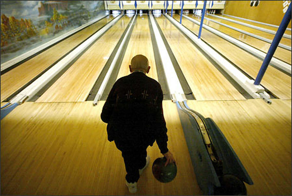 Leon Thrasher, 98, of North Bend looks to pick up a spare at Adventure Bowling Center in Snoqualmie, where he bowls each Tuesday. He took up the game at age 70.