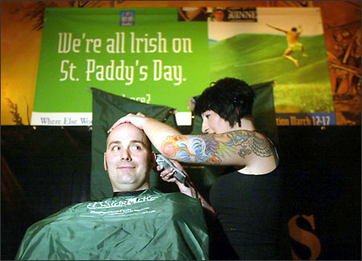 Carter Hartsell, a survivor of T-cell lymphoma during his teens, has his head shaved by Rebekah Charnes at Fado Irish Pub and Restaurant near Seattle's Pioneer Square. The occasion was a fund-raiser to aid the national Childhood Cancer Foundation. St. Baldrick's 2004, as the event was called, is a day that brave souls nationwide raise money for the foundation.
