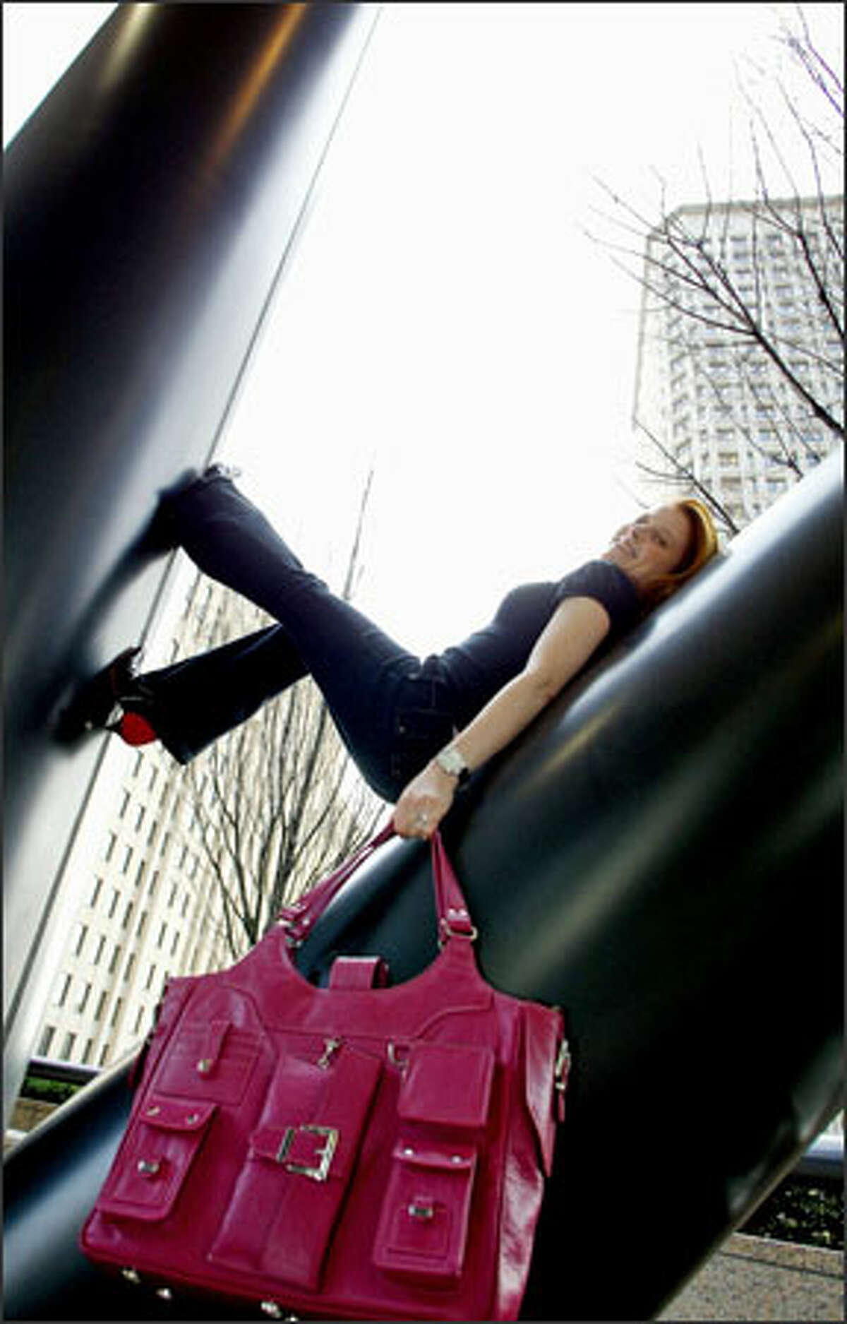 Lauren Selig shows off her Paris laptop bag, which she produces through her company, Lala. Selig's mission: to create bags that look great and are practical as well.