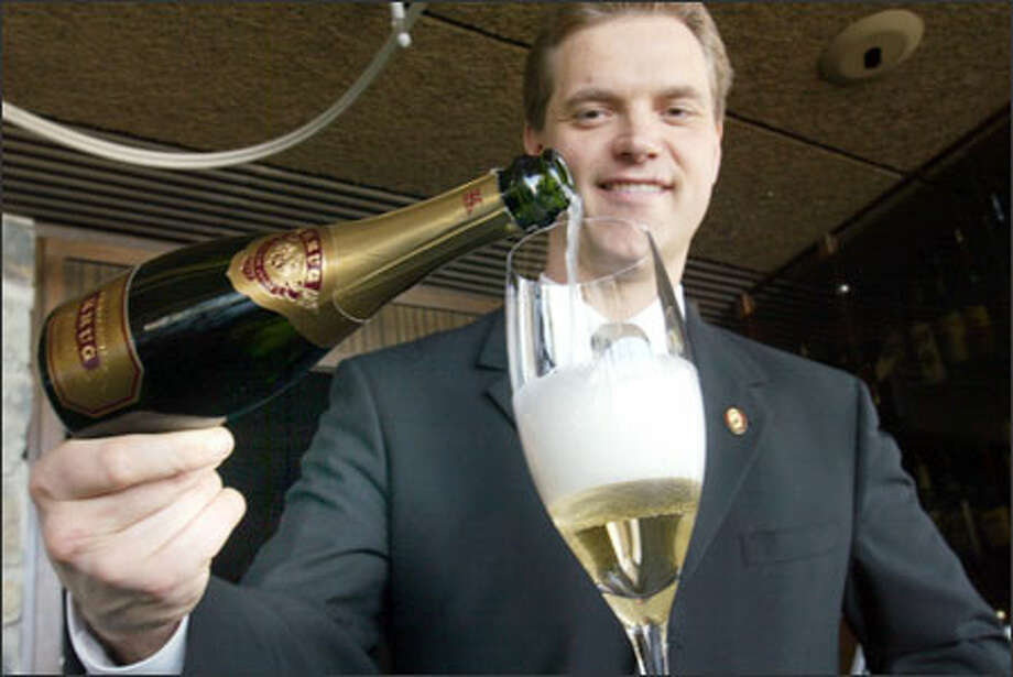 Five years of training paid off for wine expert Shayn Bjornholm of Canlis Restaurant, who passed the three-day Court of Master Sommeliers exam with the top score among his fellow candidates. Photo: Phil H. Webber, Seattle Post-Intelligencer / Seattle Post-Intelligencer