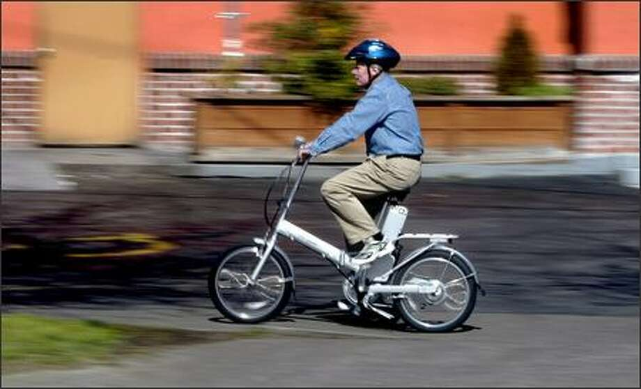 Eric Sundin, owner of Electric Bikes Northwest, says a car would need to get 1,000 mpg to measure up to the energy efficiency of an electric bike. Photo: Gilbert W. Arias, Seattle Post-Intelligencer / Seattle Post-Intelligencer