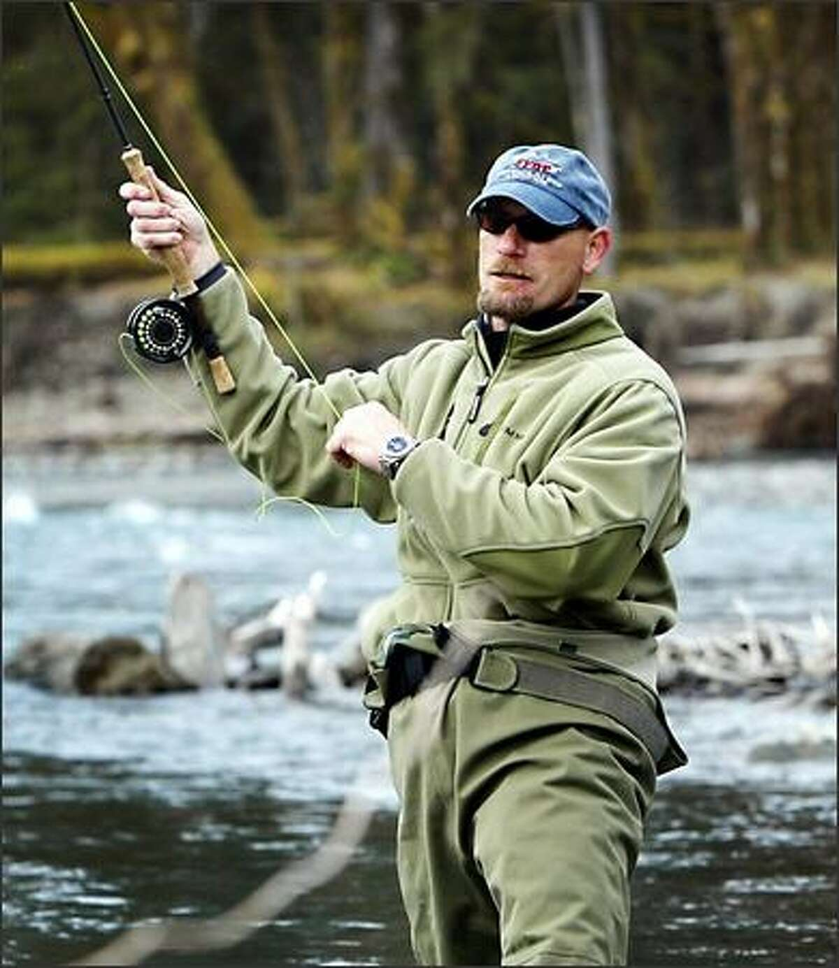 Former Mariners right-fielder Jay Buhner mends his line while drifting his line through a run on the Hoh River.