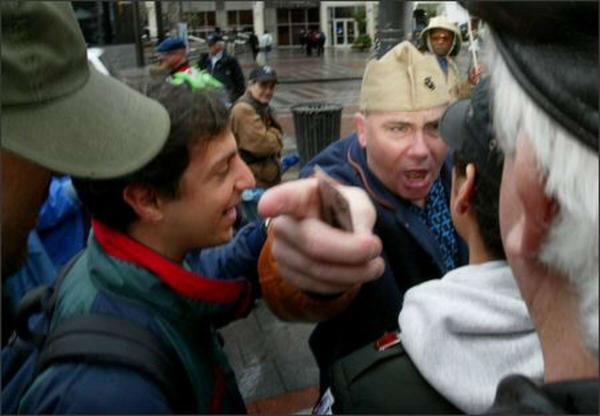 Earl Parker (from Chicago) argues with another vet during an anti-war rally called Troops Home Now at Westlake Center in Seattle on Monday. Parker said he fought as a marine in Vietnam and Desert Storm and supports the Iraq War.