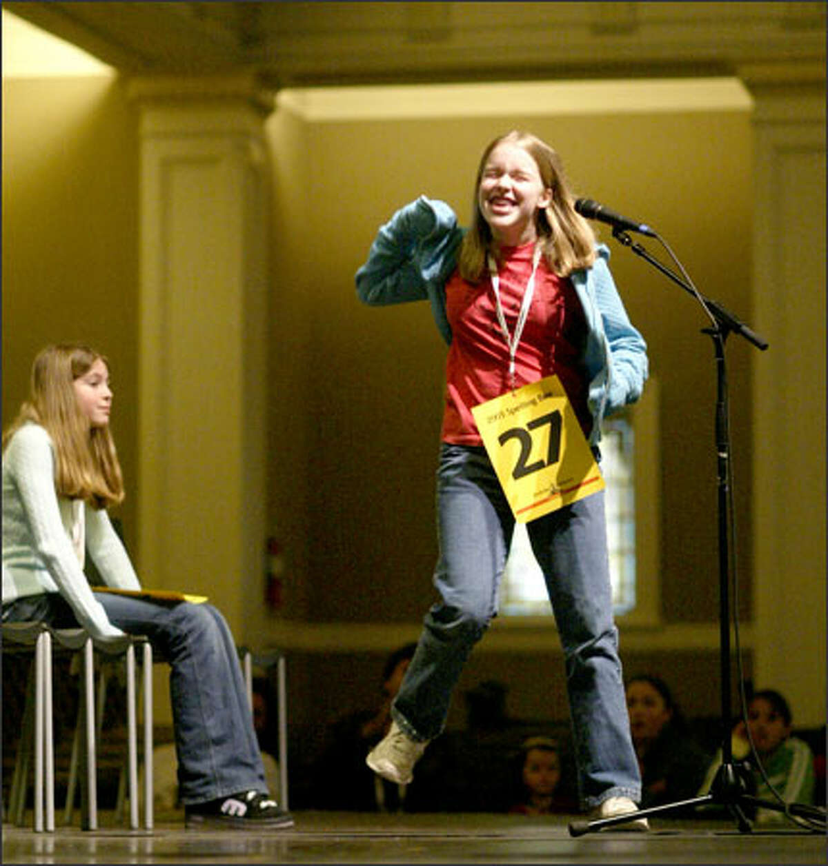 Seventh-grader Claire Nieman of Bothell reacts after winning the spelling bee for King and Snohomish counties for the second year in a row by spelling