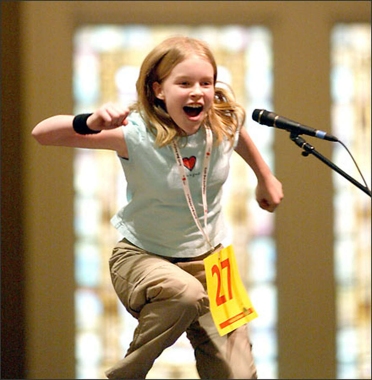 Sixth-grader Claire Nieman celebrates after spelling the winning word at the Regional Spelling Bee at Town Hall in Seattle.