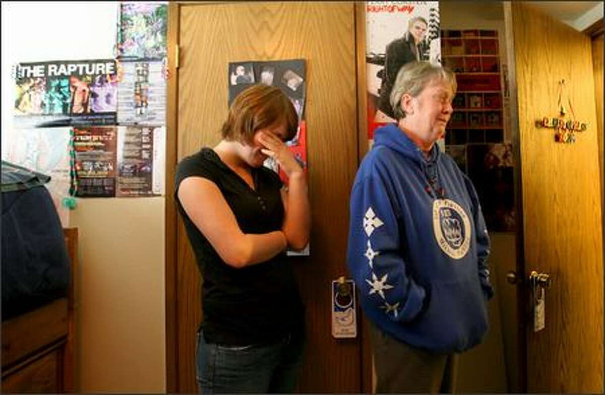 It's been one year since six people were killed by a suicidal gunman in Capitol Hill. Sandie Williamson, right, mother of Christopher Williamson, one of the six who were killed, and Christopher's best friend Jessie become emotional as they looked around Christopher's room, which is the way he left it the day he was killed.