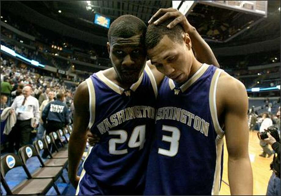 UW seniors Jamaal Williams, left, and Brandon Roy console each other after the abrupt end of their college basketball careers Friday night, March 24, when the Huskies lost to Connecticut. Photo: Joshua Trujillo, Seattlepi.com / seattlepi.com