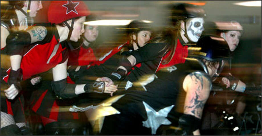 The Rat City Rollergirls opened their 2005 season at Southgate Roller Rink in White Center working the jam and trying to knock each other down. Photo: Karen Ducey, Seattle Post-Intelligencer / Seattle Post-Intelligencer
