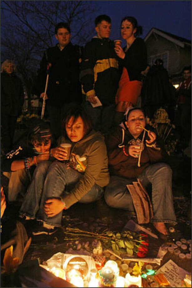"""Kevin """"Prophet Science"""" Reinholtz, left, and Elaina """"Shigh Whiskey"""" Gonzales, both 16, are meditative, while Melissa """"Matches Whiskey"""" Hollaway, 17, blows bubbles at a memorial for the shooting victims. Photo: Meryl Schenker, Seattle Post-Intelligencer / Seattle Post-Intelligencer"""
