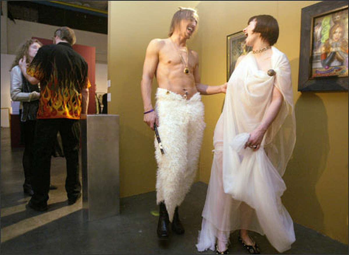 """Elija (one name only), who also answers to """"Hey, goatboy!"""" and his fiancee, Angelica Hitzman, laugh as they tour the festival, the theme of which included """"Deities of Eros."""" Costumes were optional."""