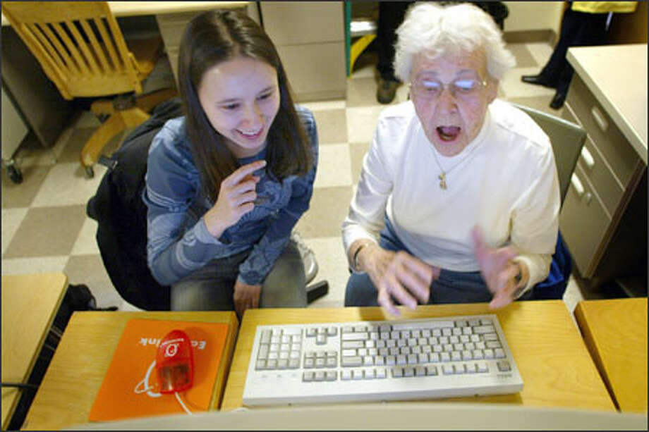 Katherine Herndon, 89, sends her first e-mail with the help of her young instructor, Ana-Maria Standolariu, 17, during a computer class at Ballard High School. Photo: Joshua Trujillo, Seattlepi.com / Seattle Post-Intelligencer