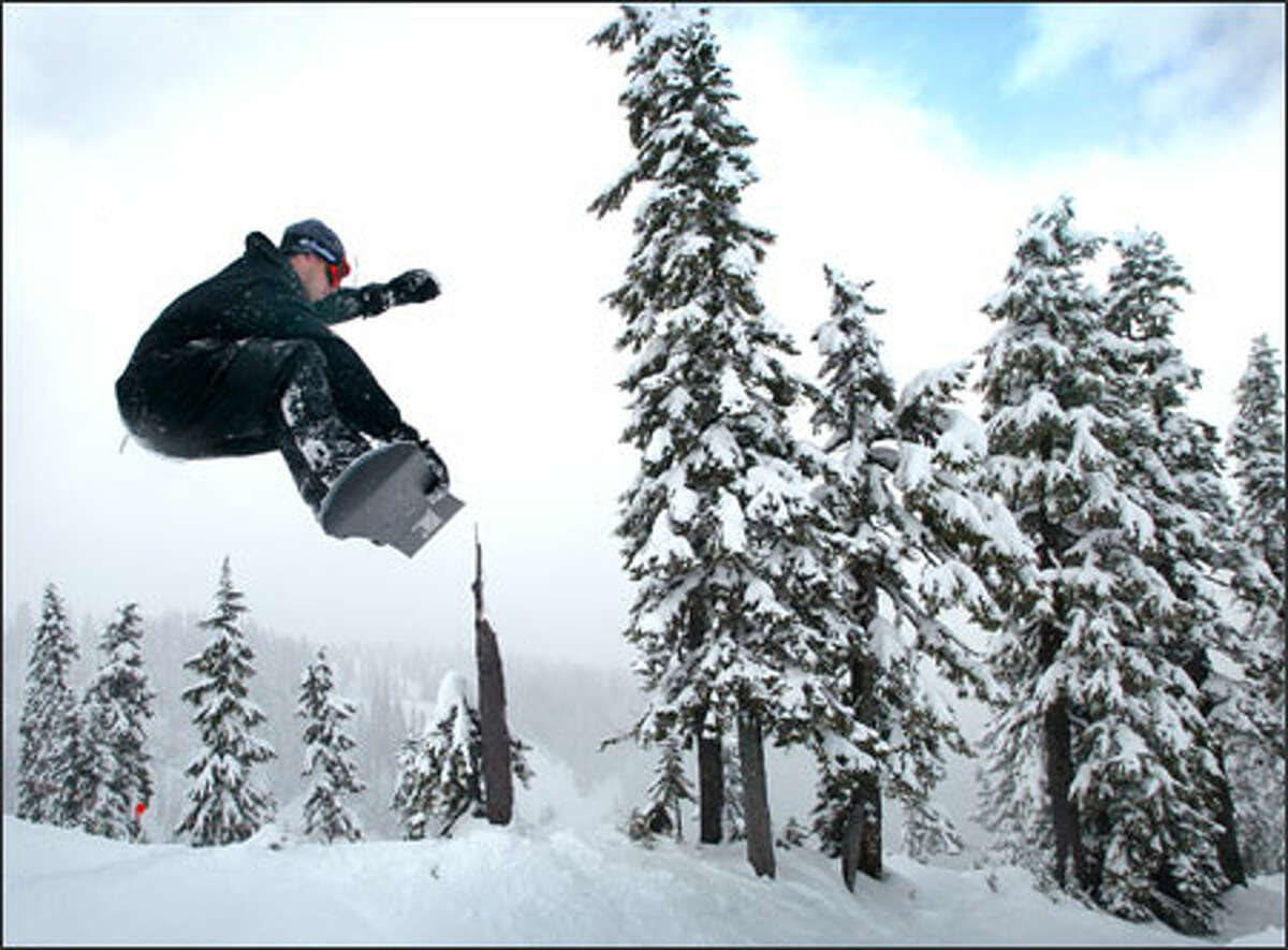 A snowboarder enjoys fresh snow on Natural Half Pipe at Mt. Baker, which reported a base-area snow depth of 63 inches -- a sharp turnaround from a dismal winter.