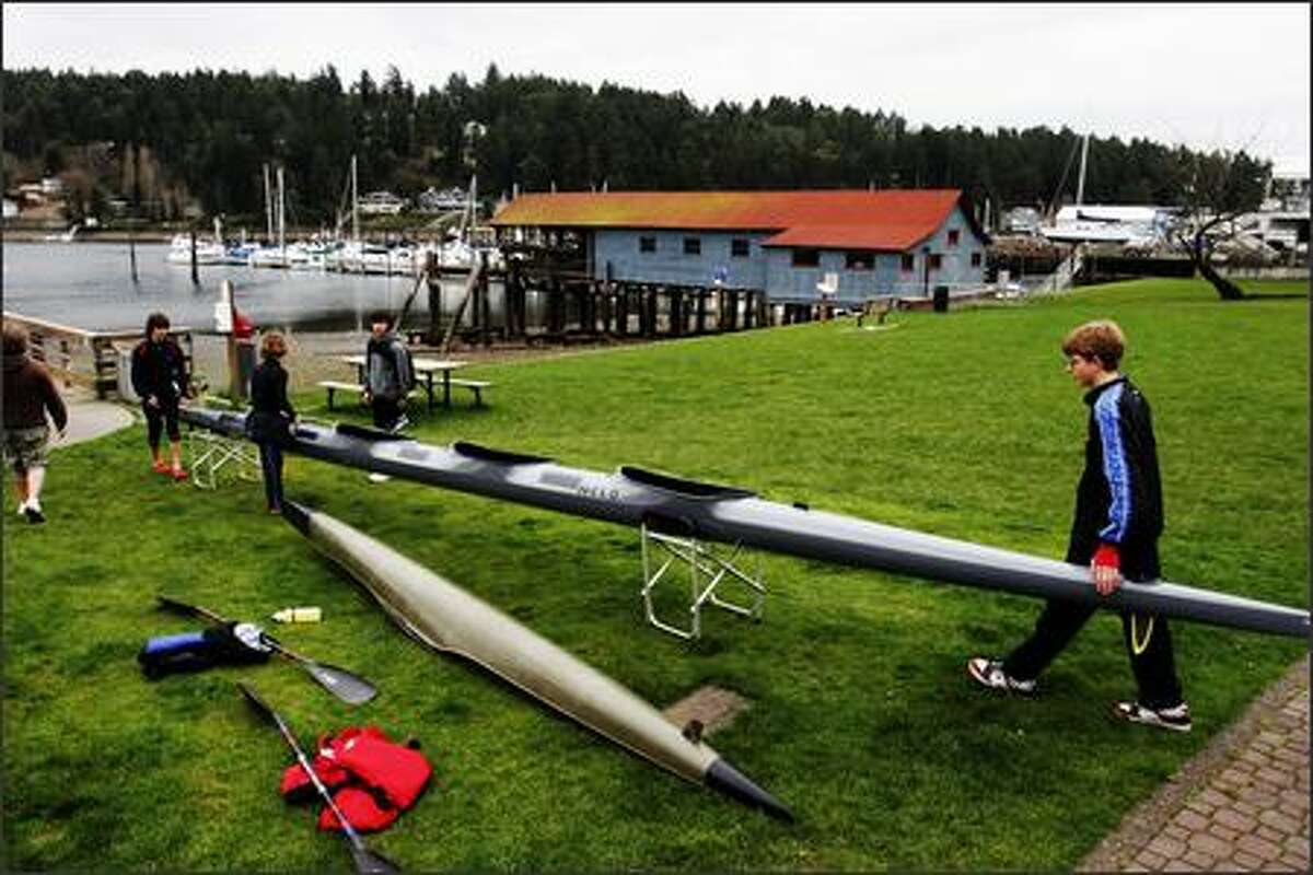 Members of the Gig Harbor Canoe and Kayak racing team, with visiting guests from Vancouver B.C., including Cameron MacLean, right, get ready for practice at the Skansie Brothers Park in downtown Gig Harbor.