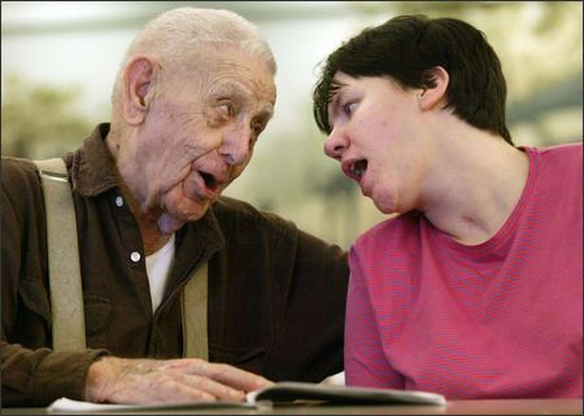 """Phil """"Mr. B"""" Bellefuielle and Jennifer Graham sing along to """"Take Me Out to the Ballgame"""" at Providence Mount St. Vincent in West Seattle. Graham, 33, was severely brain-damaged several years ago in a traffic accident, and Mr. B, 96, befriended her."""