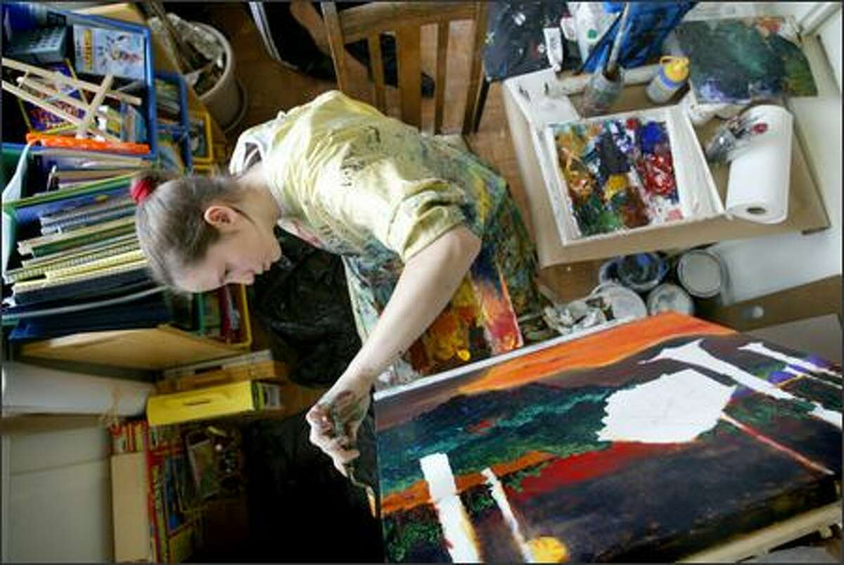 Alicia Crowley paints Thursday in her Mount Baker home. The 14-year-old is getting her first solo show at Arthead Gallery in Wallingford.
