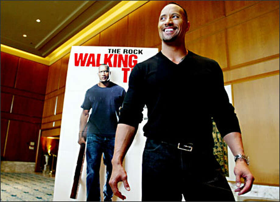 "The Rock, née Dwayne Johnson, reveals his true persona while in Seattle last week to promote his latest film, ""Walking Tall."" Photo: Paul Joseph Brown, Seattle Post-Intelligencer / Seattle Post-Intelligencer"