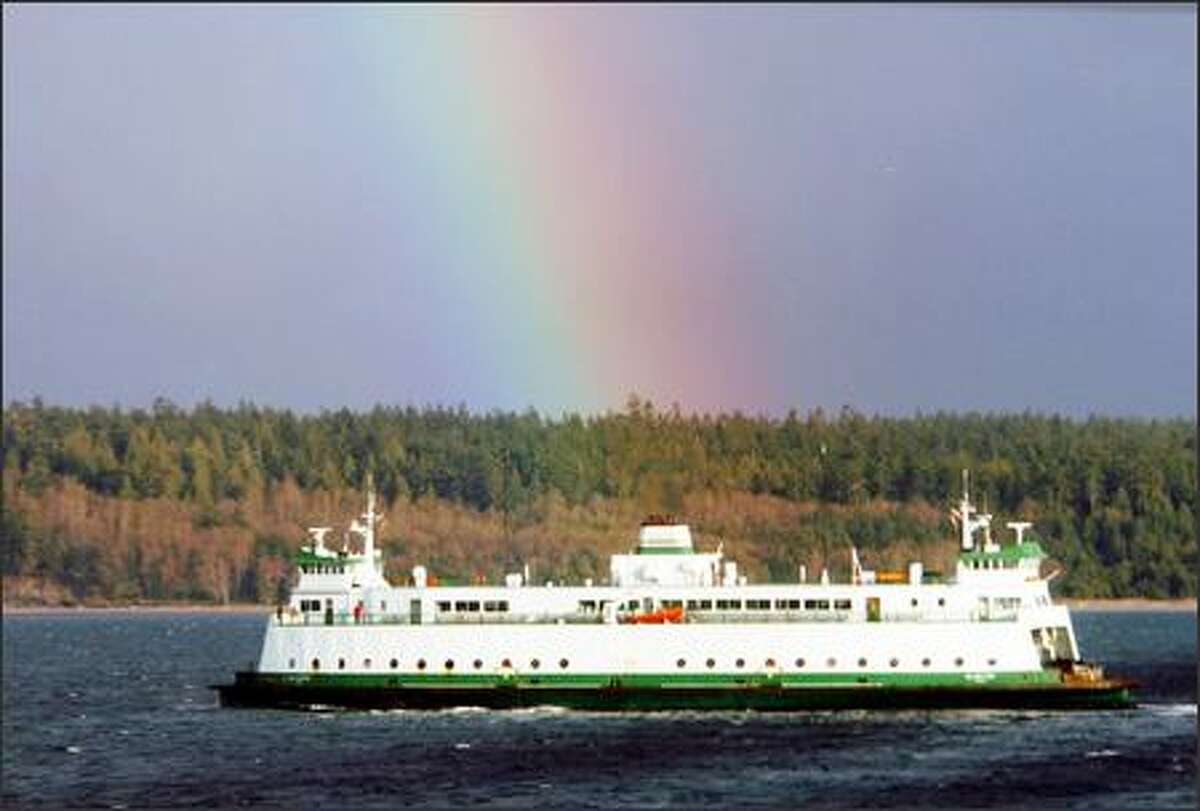 Passengers on the Glacier Spirit get a colorful postcard-perfect view of a rainbow as they cruise through Admiralty Inlet.