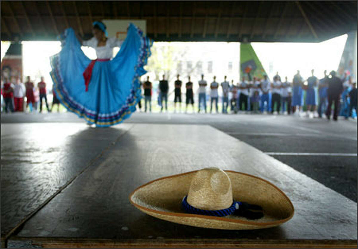 Mexican dancer Rebecca Silva, 10, performs at center court as players line the edges during opening ceremonies Sunday for Seattle's Liga Latina de Basketball.