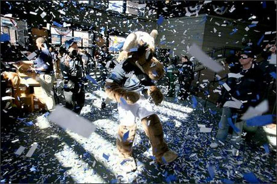 Mariners fans and the team mascot, the Mariner Moose, are showered with confetti as they enter Safeco Field to see the home team beat the Oakland A's 4-0 on opening day of the 2007 baseball season. Photo: Scott Eklund, Seattle Post-Intelligencer / Seattle Post-Intelligencer