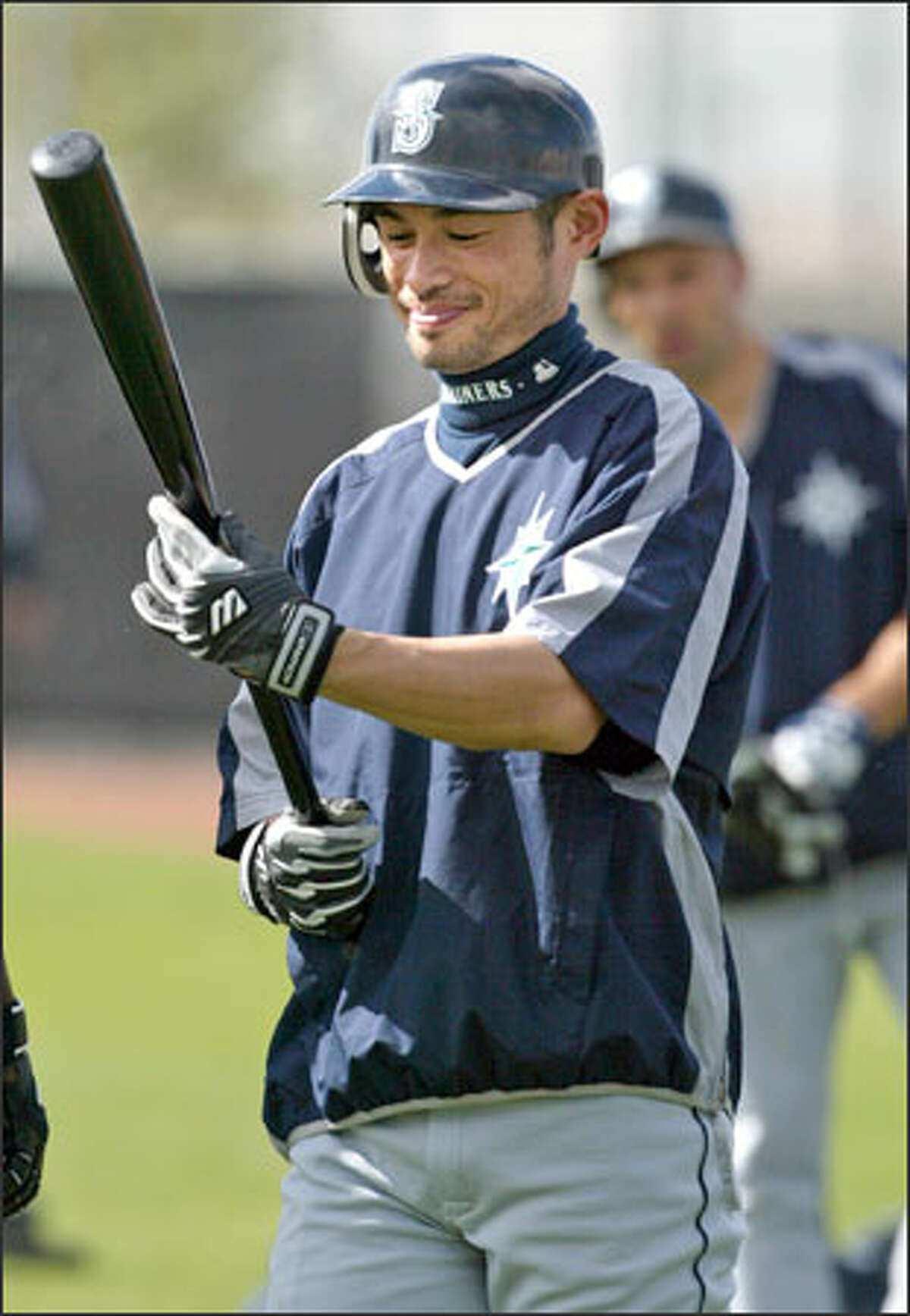 Ichiro Suzuki carries the tools of his trade after working out at Safeco Field in preparation for the Mariners' season opener Monday afternoon against the Minnesota Twins.