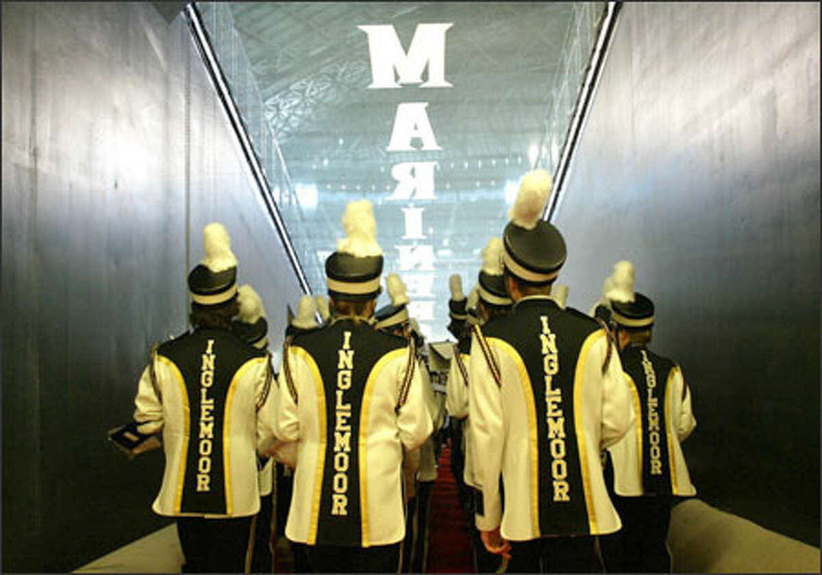 Members of the Inglemoor High School marching band prepare to strut their stuff on Safeco Field during Opening Day festivities for the Mariners' 2005 season.