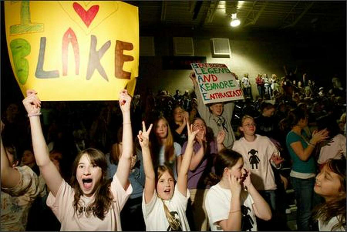 """From left, Samantha Miller, 13, Paige Skinner, 9, and Sydney Miller, 9, cheer on """"American Idol"""" contestant Blake Lewis from Kenmore Junior High School on Tuesday."""