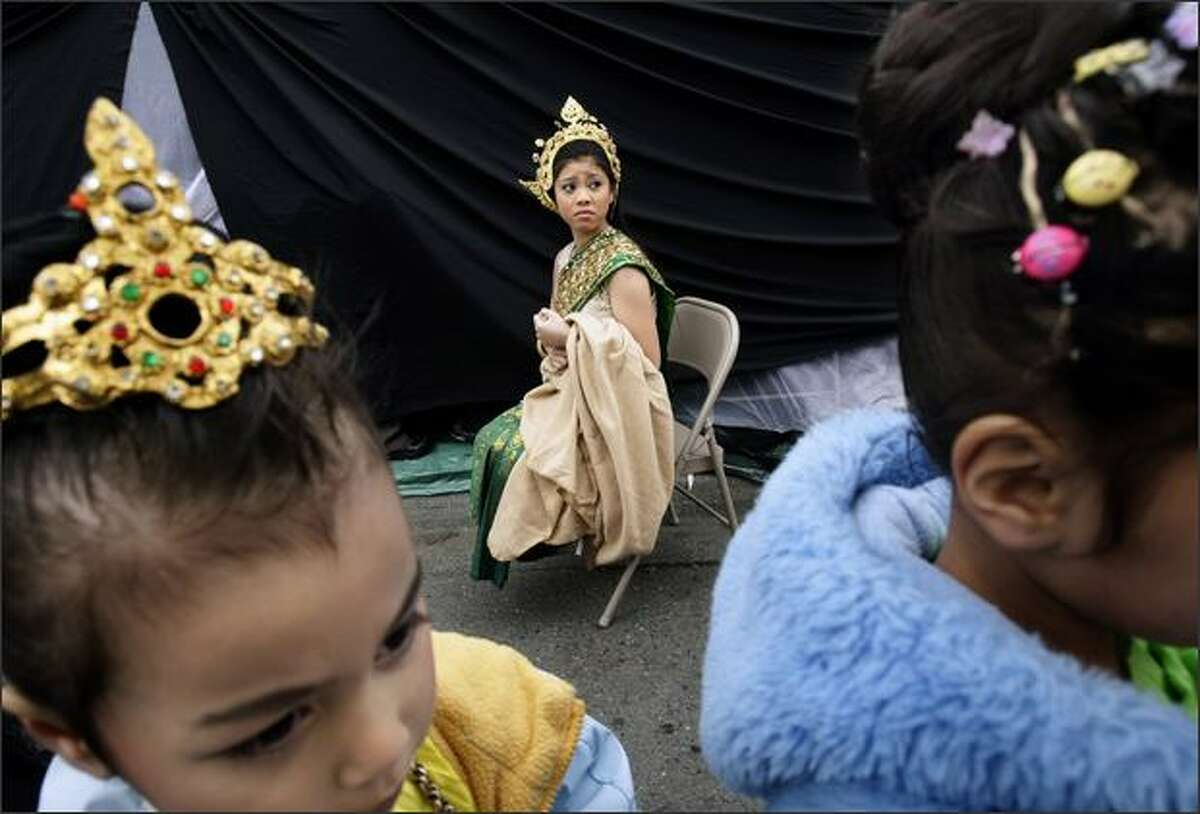 Kanika Vuthy, 12, waits in the cold with other members of the Cambodian Classical and Folk Dance of Tacoma group.