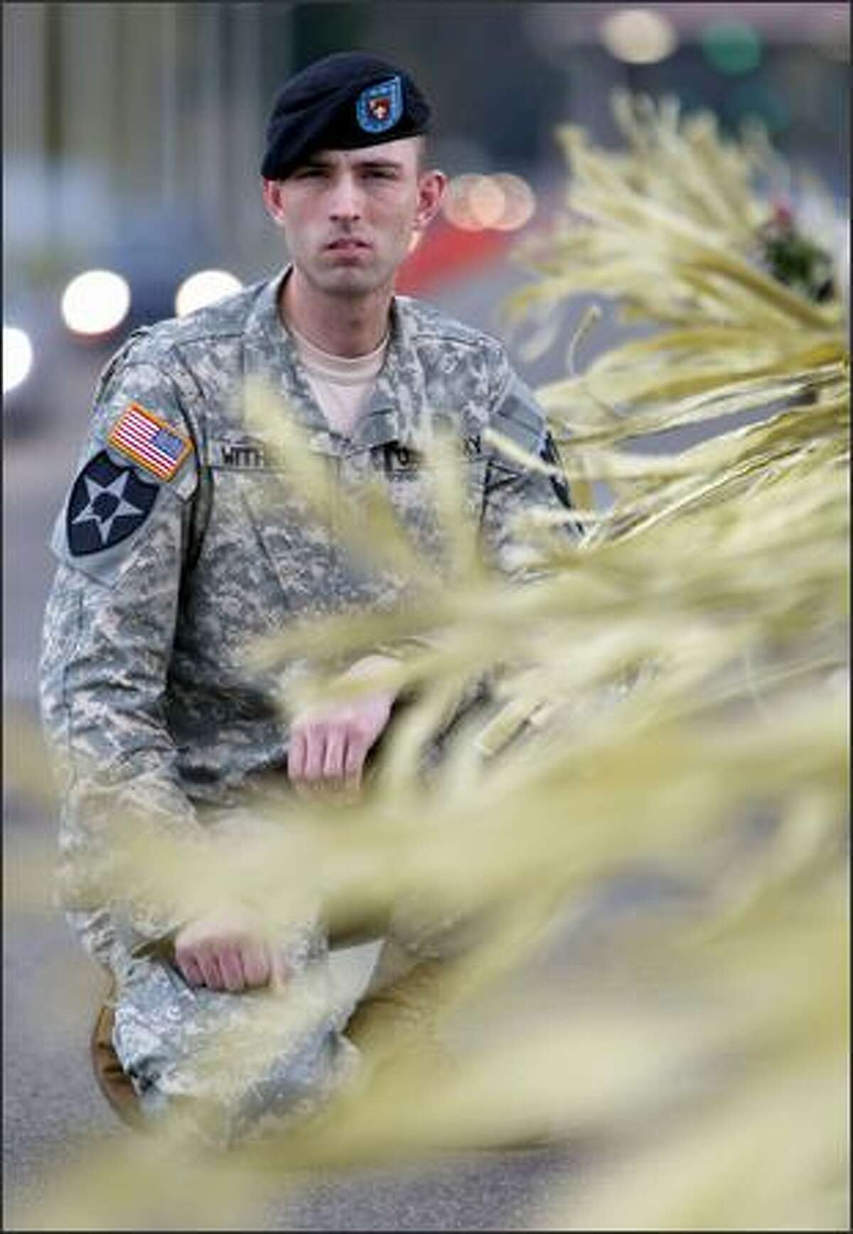U.S. Army soldier Rob Withrow, photographed among the yellow ribbons tied to the Freedom Bridge across Interstate 5 near Fort Lewis. Since his problems began, Withrow has been reduced in rank from sergeant to private.