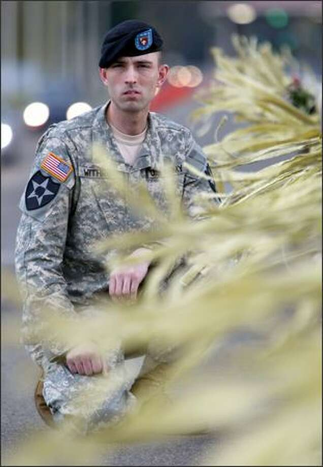 U.S. Army soldier Rob Withrow, photographed among the yellow ribbons tied to the Freedom Bridge across Interstate 5 near Fort Lewis. Since his problems began, Withrow has been reduced in rank from sergeant to private. Photo: Mike Urban, Seattle Post-Intelligencer / Seattle Post-Intelligencer