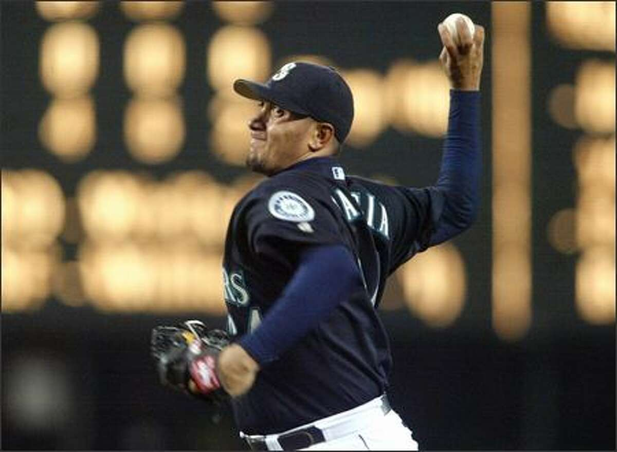 M's starter Freddy Garcia lines up a pitch in the fifth inning against Oakland at Safeco Field.