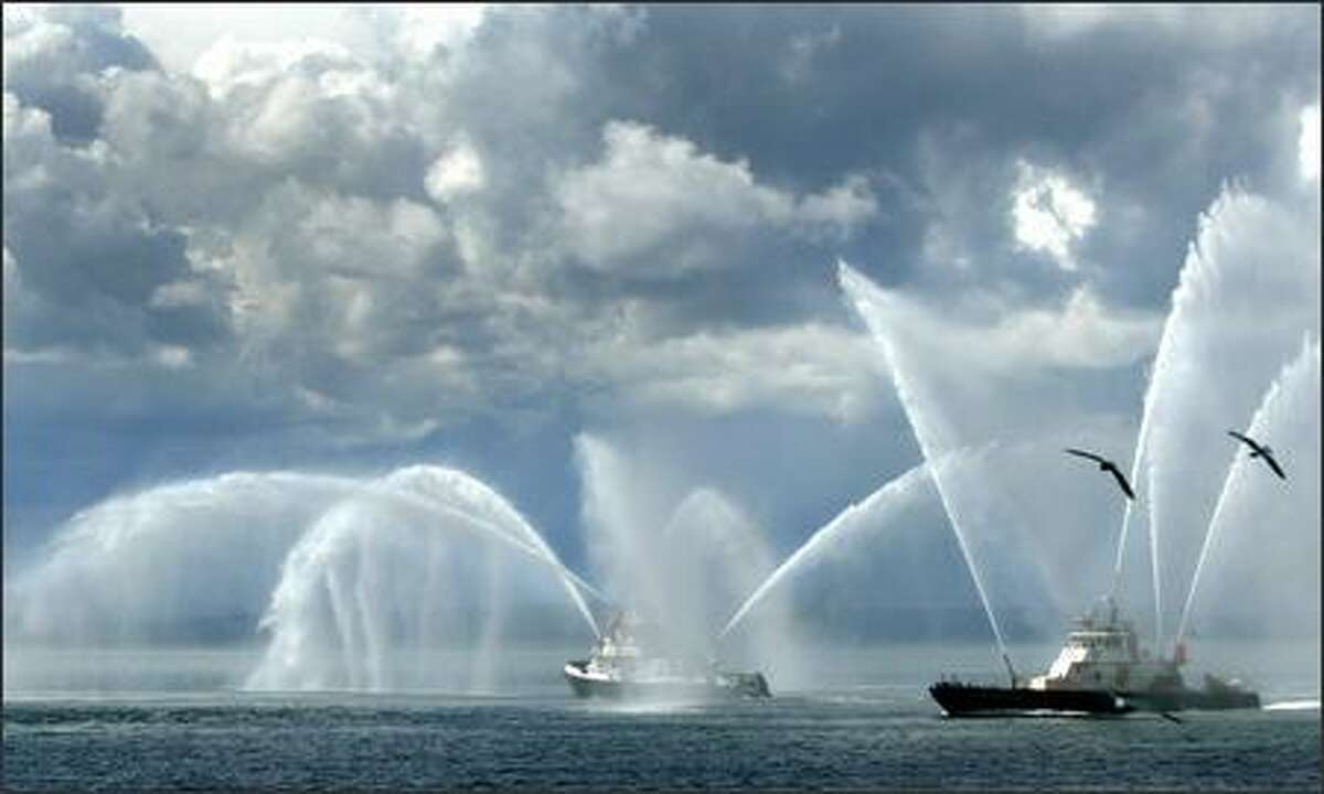 The Seattle Fire Department's new fireboat, the Leschi, shown on left, is joined by the Chief Seattle in a demonstration along Seattle's waterfront.