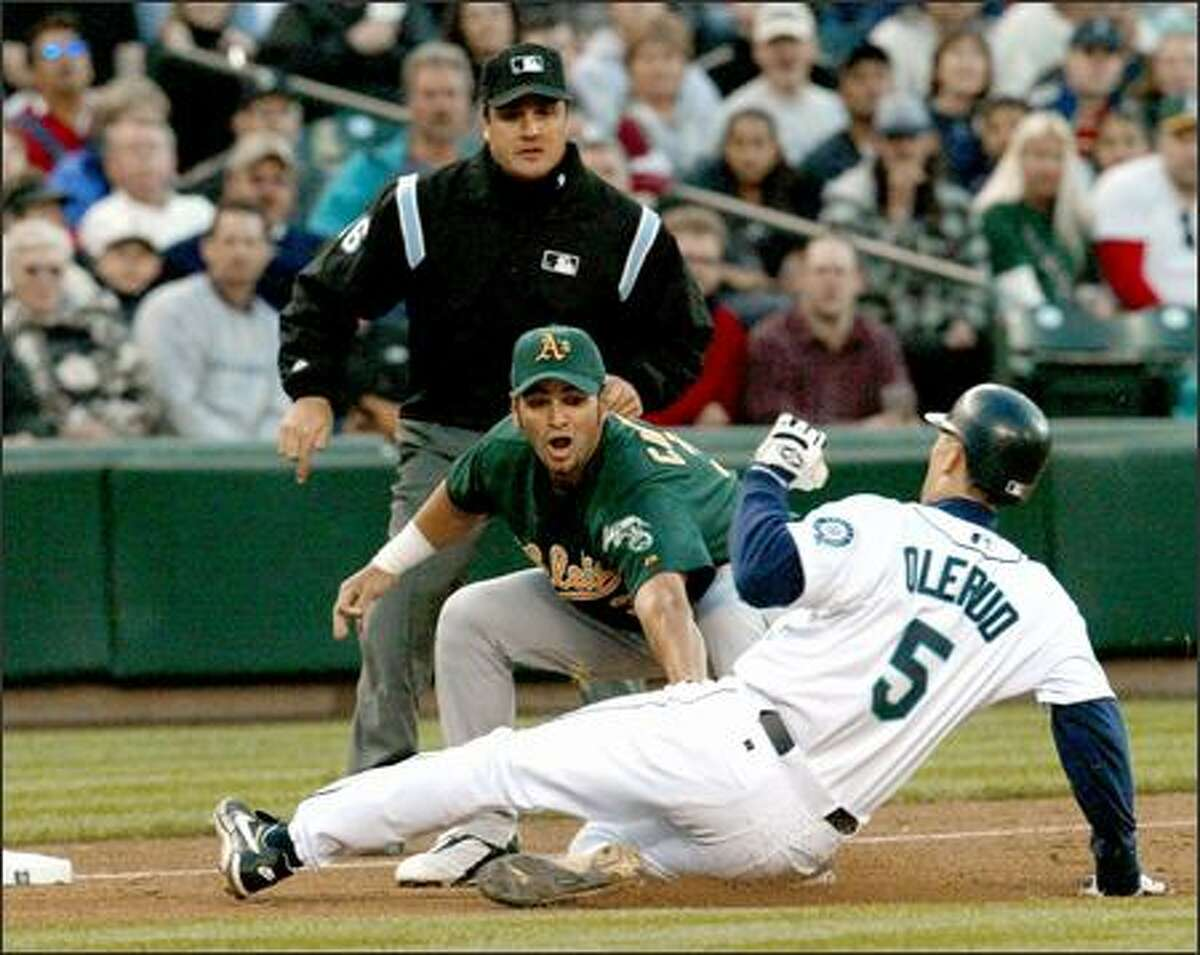 Athletics third baseman Eric Chavez tags out John Olerud in the third inning. Chavez homered leading off the top of the fourth to give Oakland a 2-0 lead.