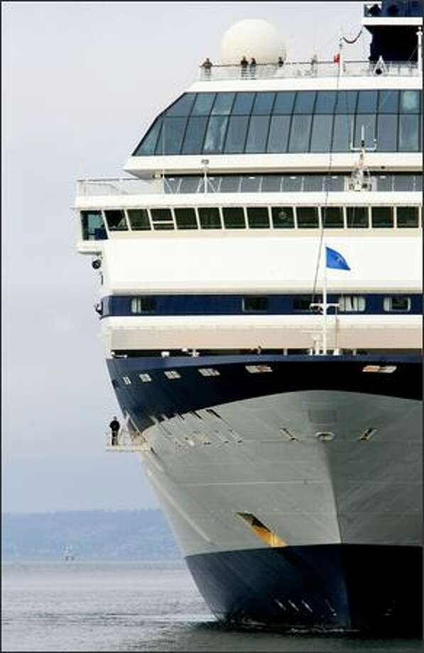 The 866-foot,, 77,713-ton Mercury, a Celebrity Cruises-class ship, arrives at Pier 66 in Seattle on Monday, the first day cruise ships arrived for the 2007 season. Photo: Dan DeLong, Seattle Post-Intelligencer / Seattle Post-Intelligencer