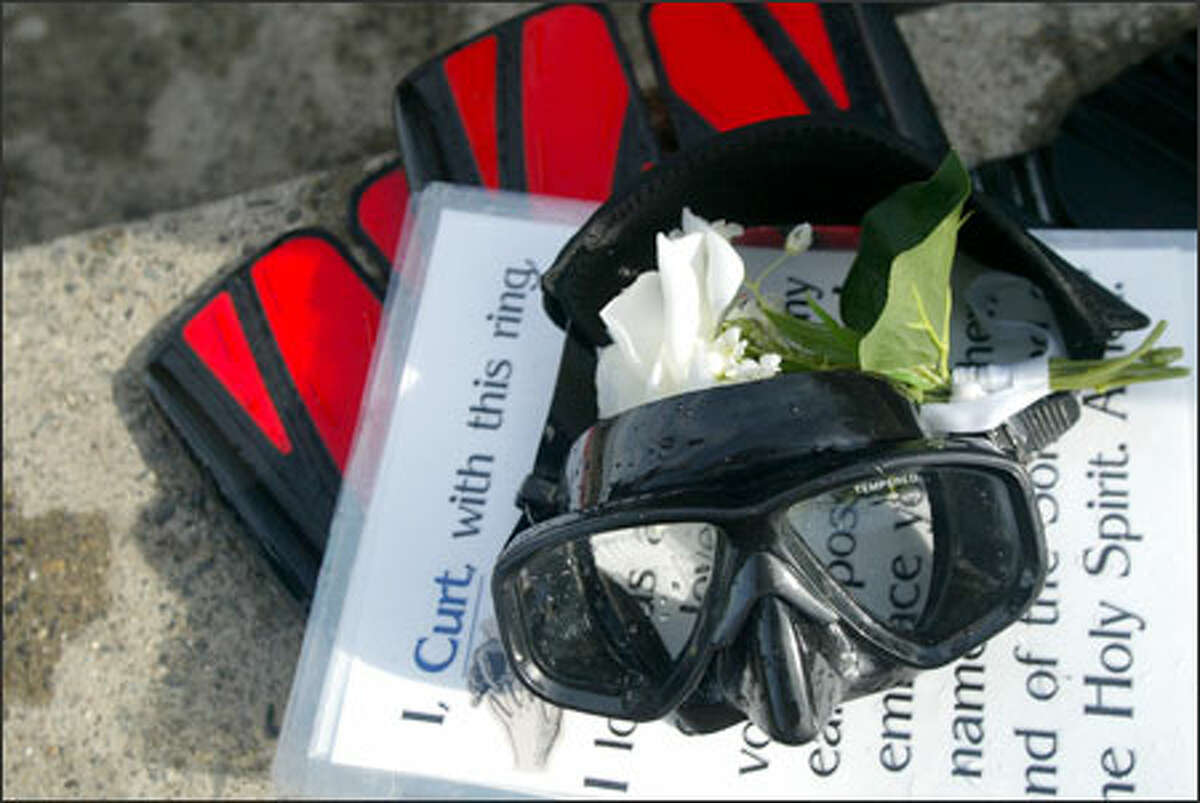 Scuba gear and plastic-encased cue cards that were used during the underwater ceremony.