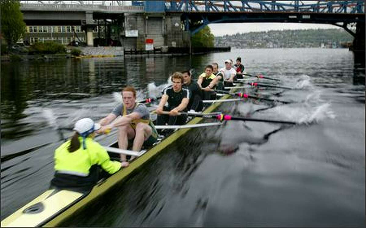 The University of Washington men's varsity eight powers toward the Fremont Bridge during early morning crew practice. The coxswain is Katelin Snyder and the stroke is Will Crothers.