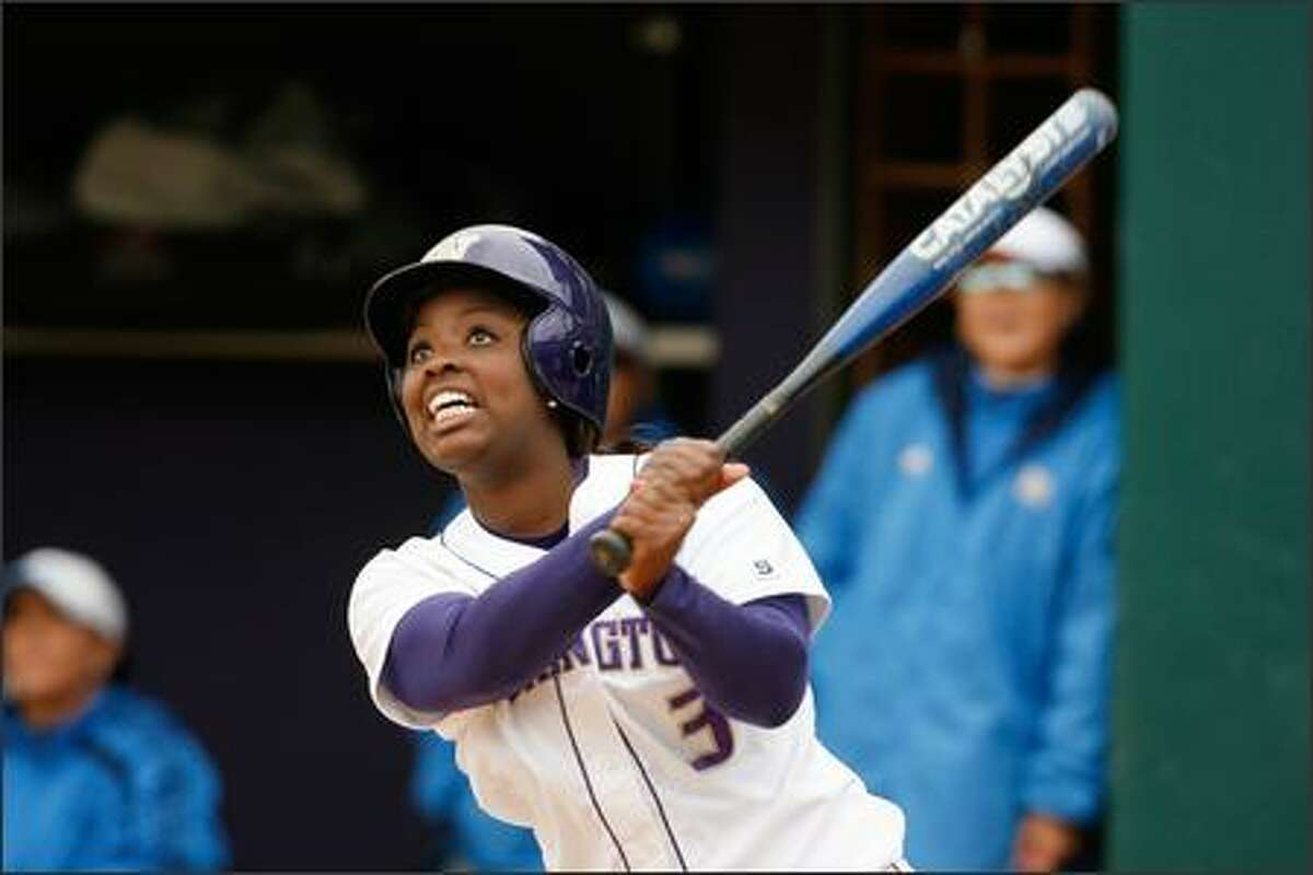 University of Washington's Dena Tyson watches her ball head for the left field fence ... only to go foul at the last moment. The Huskies beat UCLA 8-3 Wednesday, the 100th victory at the UW for head coach Heather Tarr.