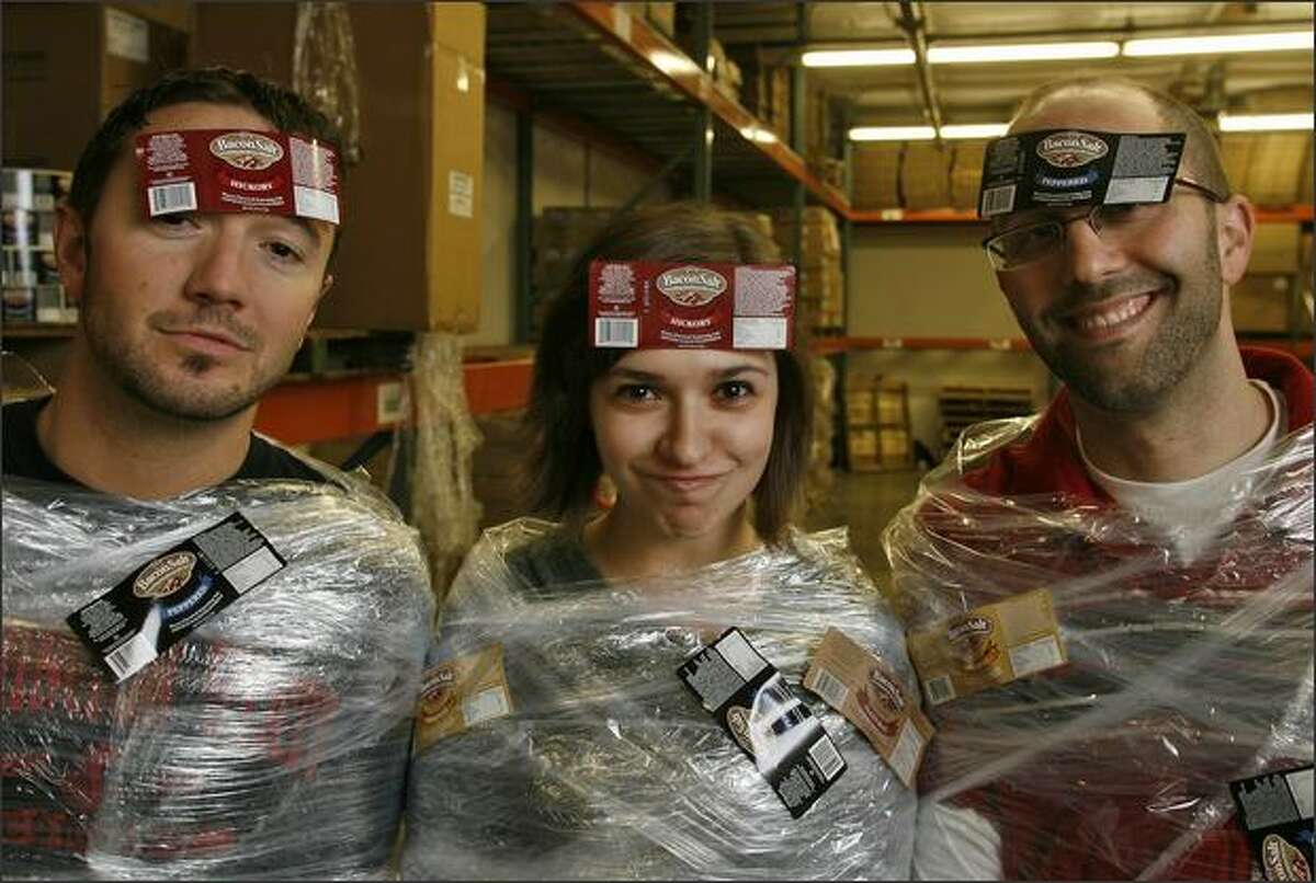 Ready to ship out to Iraq: Baconslinger Reilly Devine, operbacons manager Sarah Wayne and bacontrepreneur Dave Lefkow at their world headquarters in a small business park in South Seattle.
