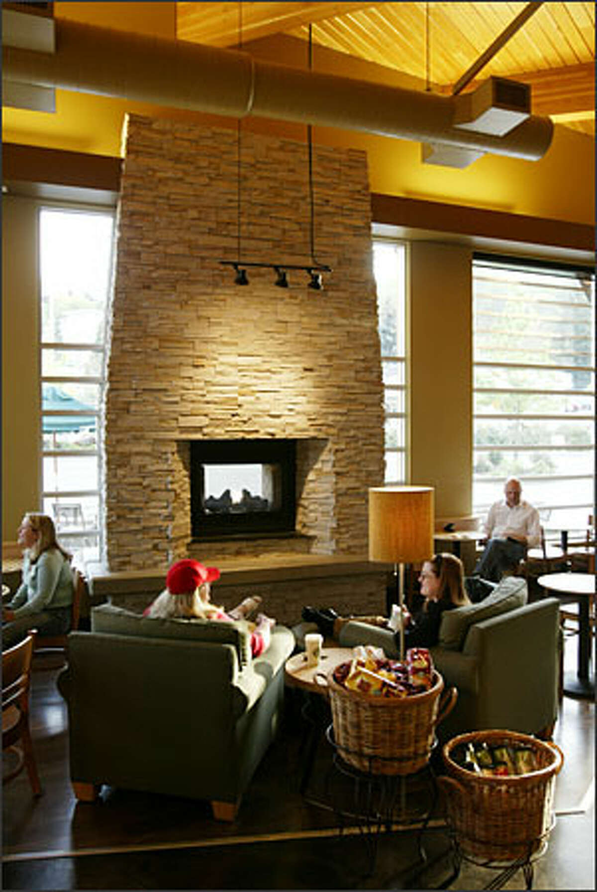 Starbucks put drama in its new Mercer Island store with an indoor/ outdoor gas fireplace.