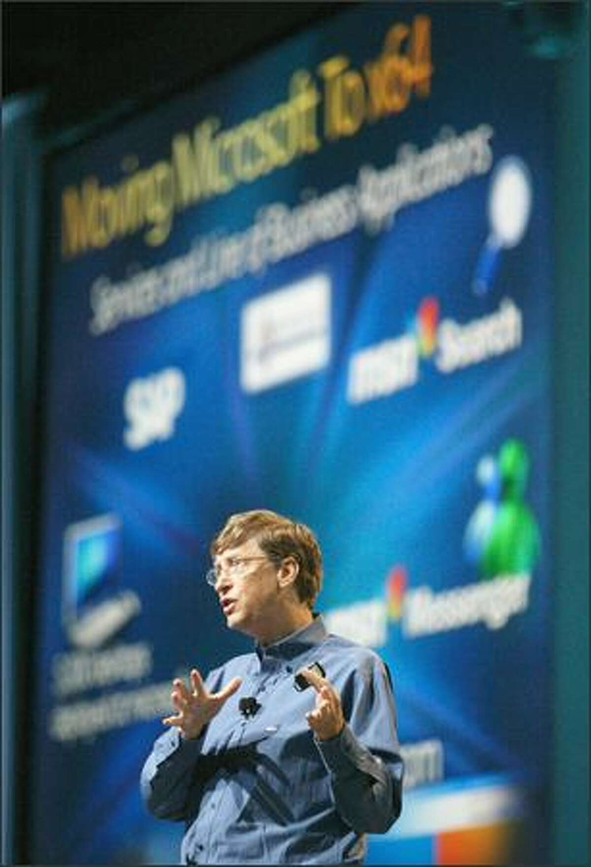 Microsoft Chairman Bill Gates touts the new features of Longhorn, the code name for the company's next-generation operating system, yesterday at the Windows Hardware Engineering Conference in Seattle.