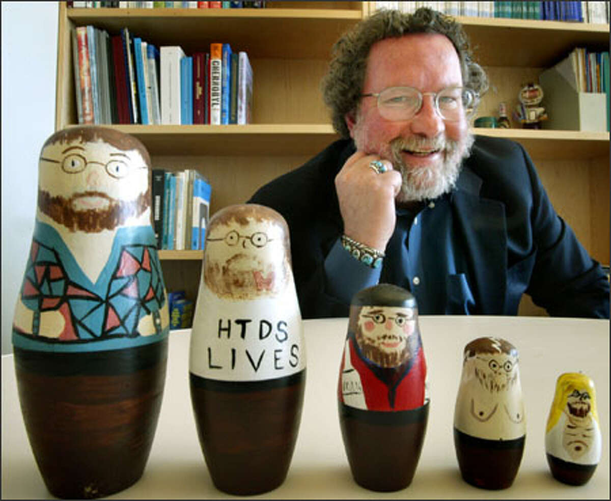 Cancer epidemiologist Scott Davis shows nesting dolls bearing his likeness in his office in the Fred Hutchinson Cancer Research Center. HTDS on one doll stands for Hanford Thyroid Disease Study.