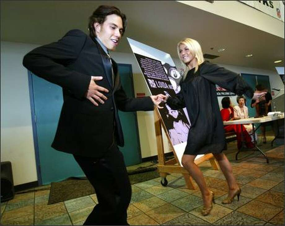 "Olympic gold medalist Apolo Anton Ohno demonstrates a dance move with Julianne Hough, his partner on ABC's ""Dancing With the Stars,"" at the Asian Hall of Fame in Seattle. Ohno  and attorney Loida Nicholas Lewis, were both inducted into the hall. Photo: Karen Ducey, Seattle Post-Intelligencer / Seattle Post-Intelligencer"