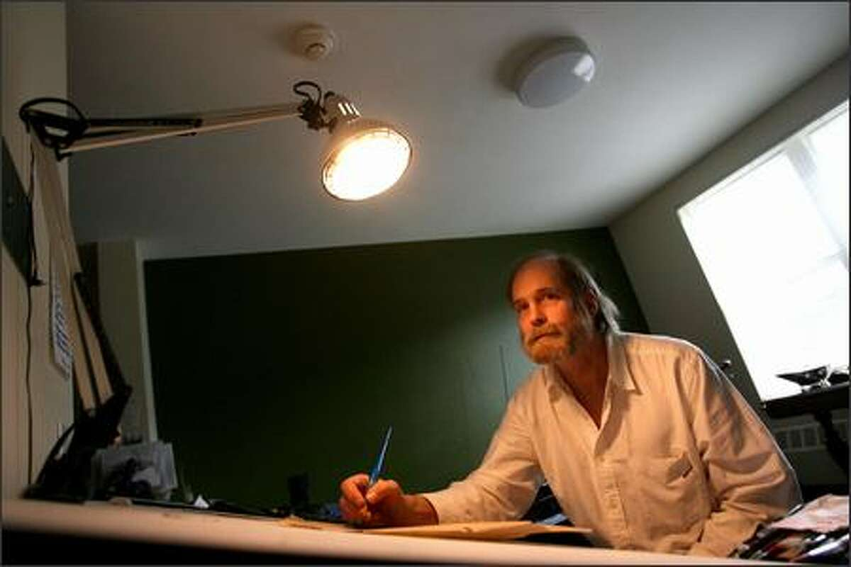 Andrew Miles at his painting table in his apartment on 1811 Eastlake Ave. Miles used to live in a church doorway by Green Lake. He was one of the few who'd gotten sober before he moved into the housing.