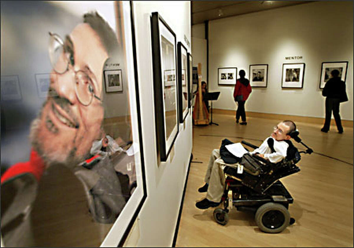 Mike Smith of Seattle attends the opening of the photo exhibit