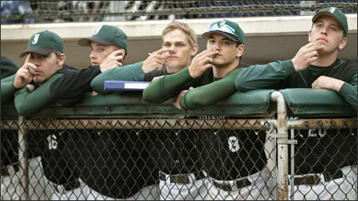 Jackson High School baseball players work in concert to conceal their team's signs to the catcher during an 8-2 victory over Everett High at Memorial Stadium in Everett. Jackson, with a 17-0 record, is ranked No. 3 in the nation. Shown here, from left, are Matt Ojala, Marc Schuermeyer, Riley Lillibridge, Kawika Emsley-Pai and Mike Jeffery.