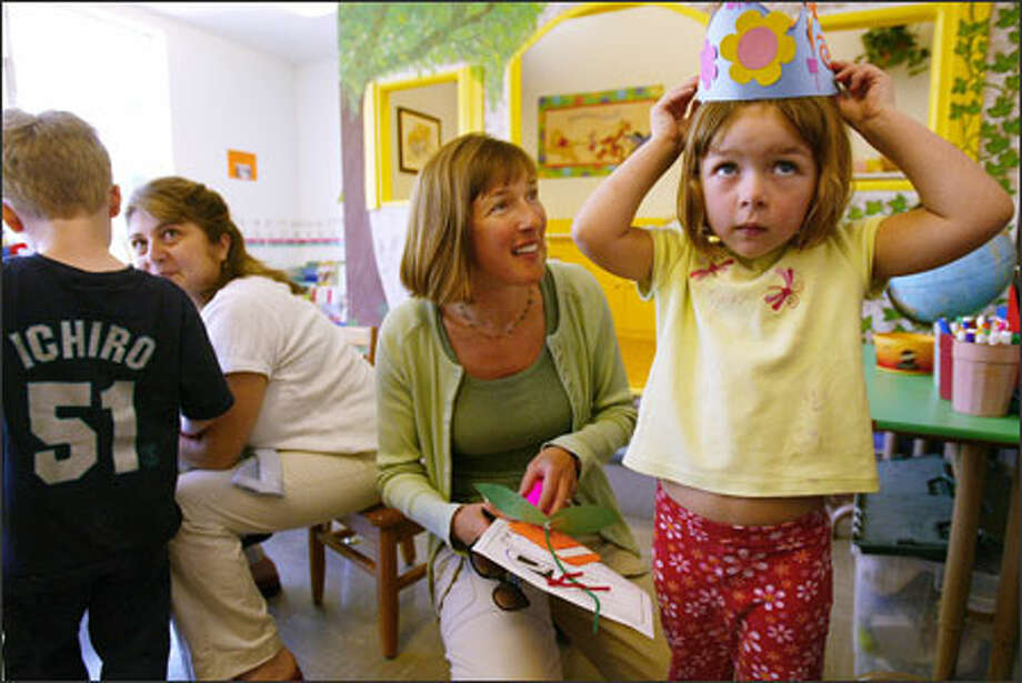 Nicole Yates gets 5-year-old Lucy ready to go after preschool in Wallingford this week. Yates wants to enroll her daughter in kindergarten at Bagley Elementary, even though the school might be closed in 2006-07. Photo: Paul Joseph Brown, Seattle Post-Intelligencer / Seattle Post-Intelligencer