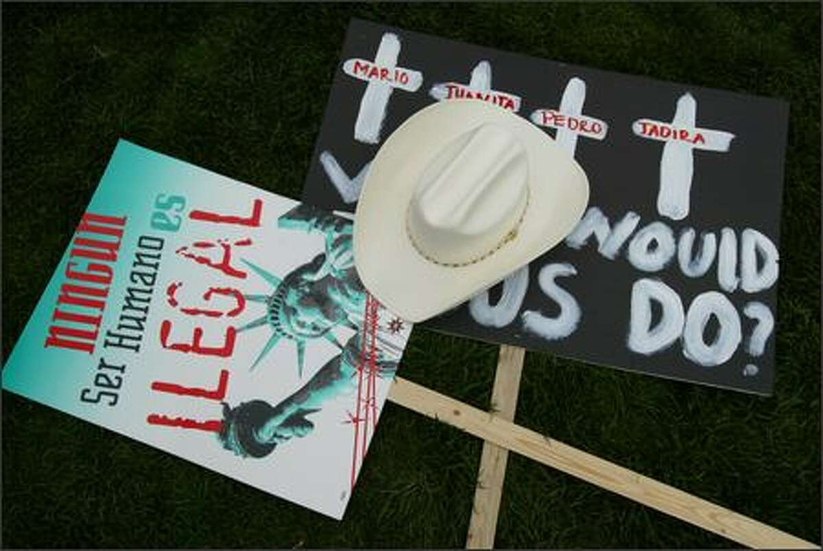 Signs and a hat rest on the ground at the Seattle Center after a march on Tuesday May 1, 2007 in Seattle. Thousands of protestors took to the Seattle streets pushing for immigration reform and an end to ICE raids that have separated many families.