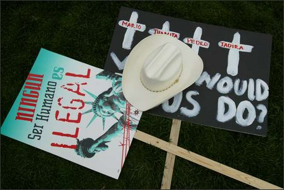 Signs and a hat rest on the ground at the Seattle Center after a march on Tuesday May 1, 2007 in Seattle. Thousands of protestors took to the Seattle streets pushing for immigration reform and an end to ICE raids that have separated many families. Photo: Joshua Trujillo, Seattlepi.com / seattlepi.com