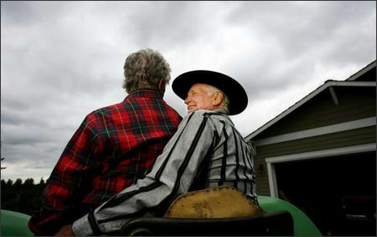Don (right) and Toni Ihry sit atop one of the many tractors they own at their home in Kent. A Boeing exec and workaholic, Don, takes up tractor pulling (as in competitions) after his wife gave him a tractor as a gift to help distract him from work. He's retired now, but still operates a side business.